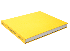 A hardback book with a yellow cover.