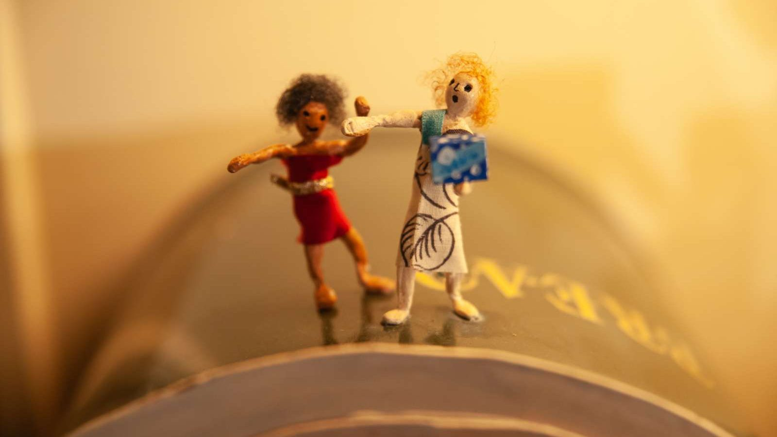 Close up of two miniature doll figures