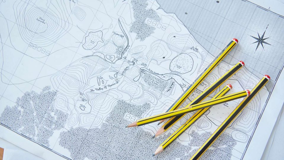 Close up of pencils on top of a paper map