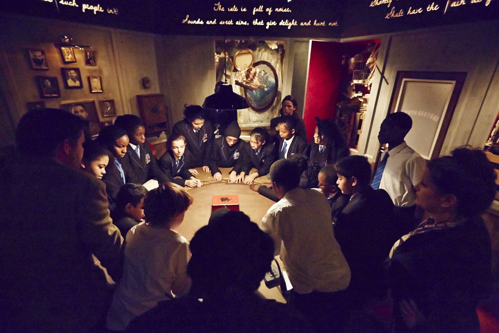 A group of school children gathered around a table.