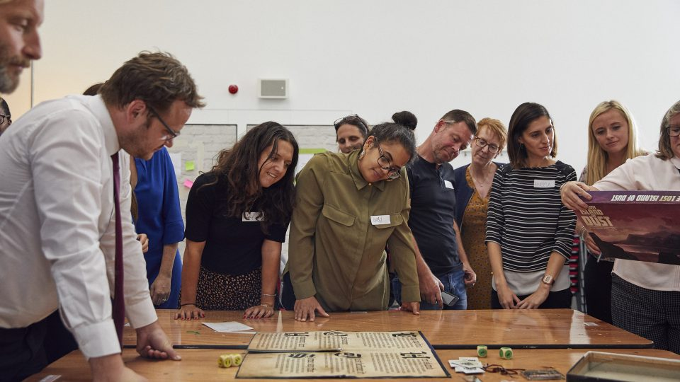 Teachers looking at a board game on a table