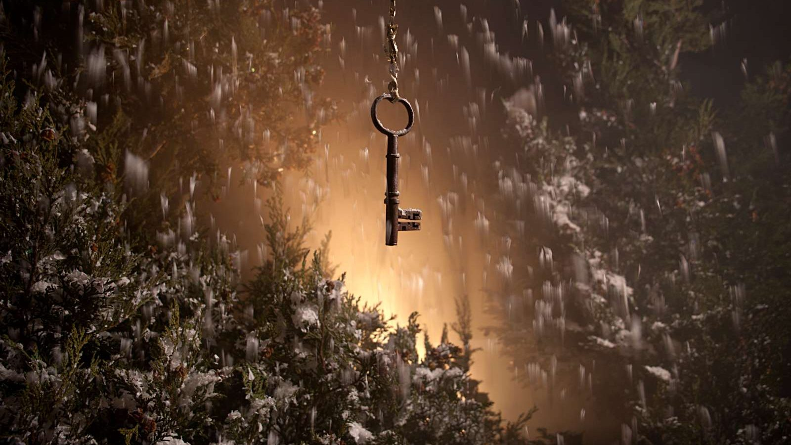 In a snowy setting, a key hangs on a chain in front of some partially shown trees