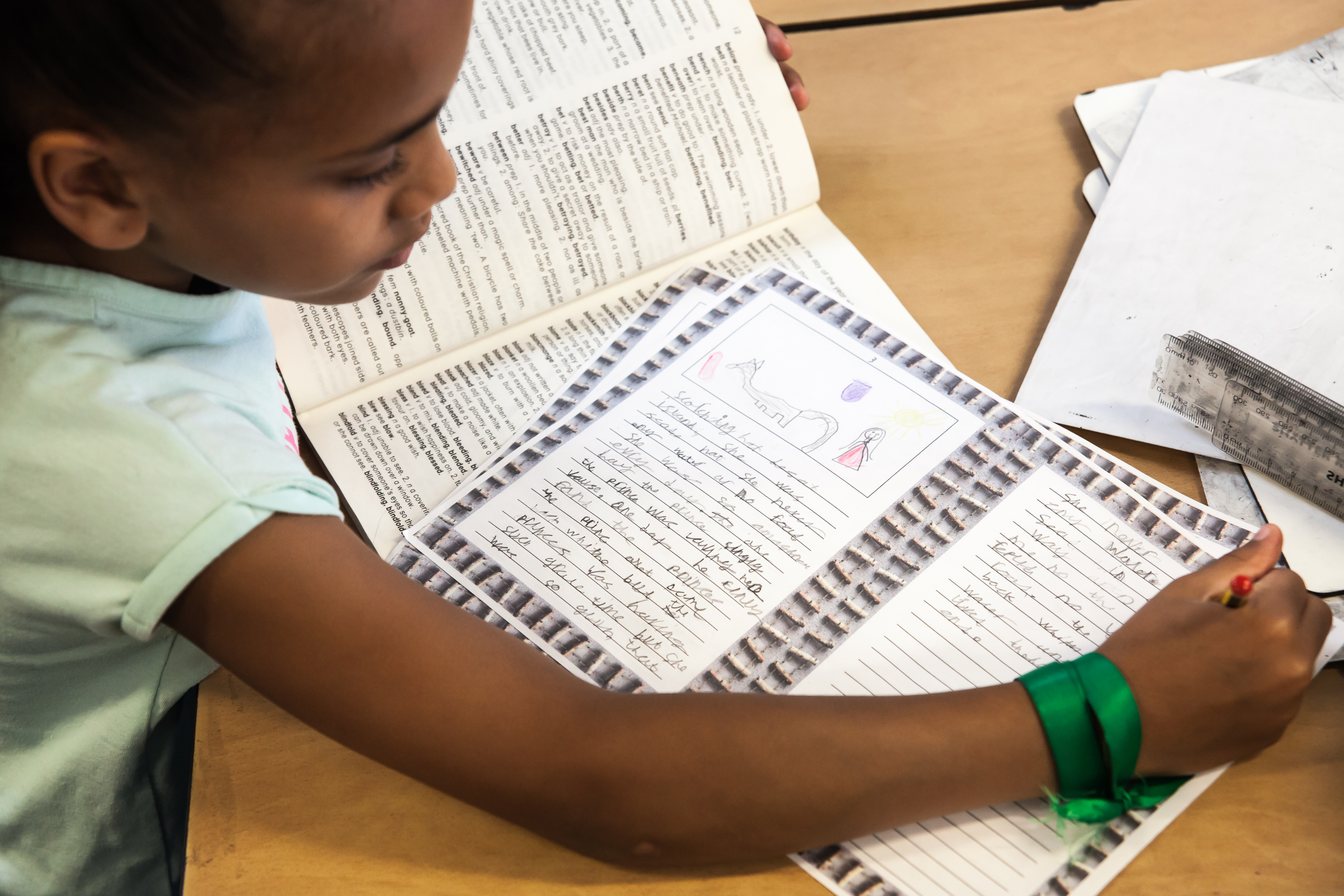 Child sitting at a table writing