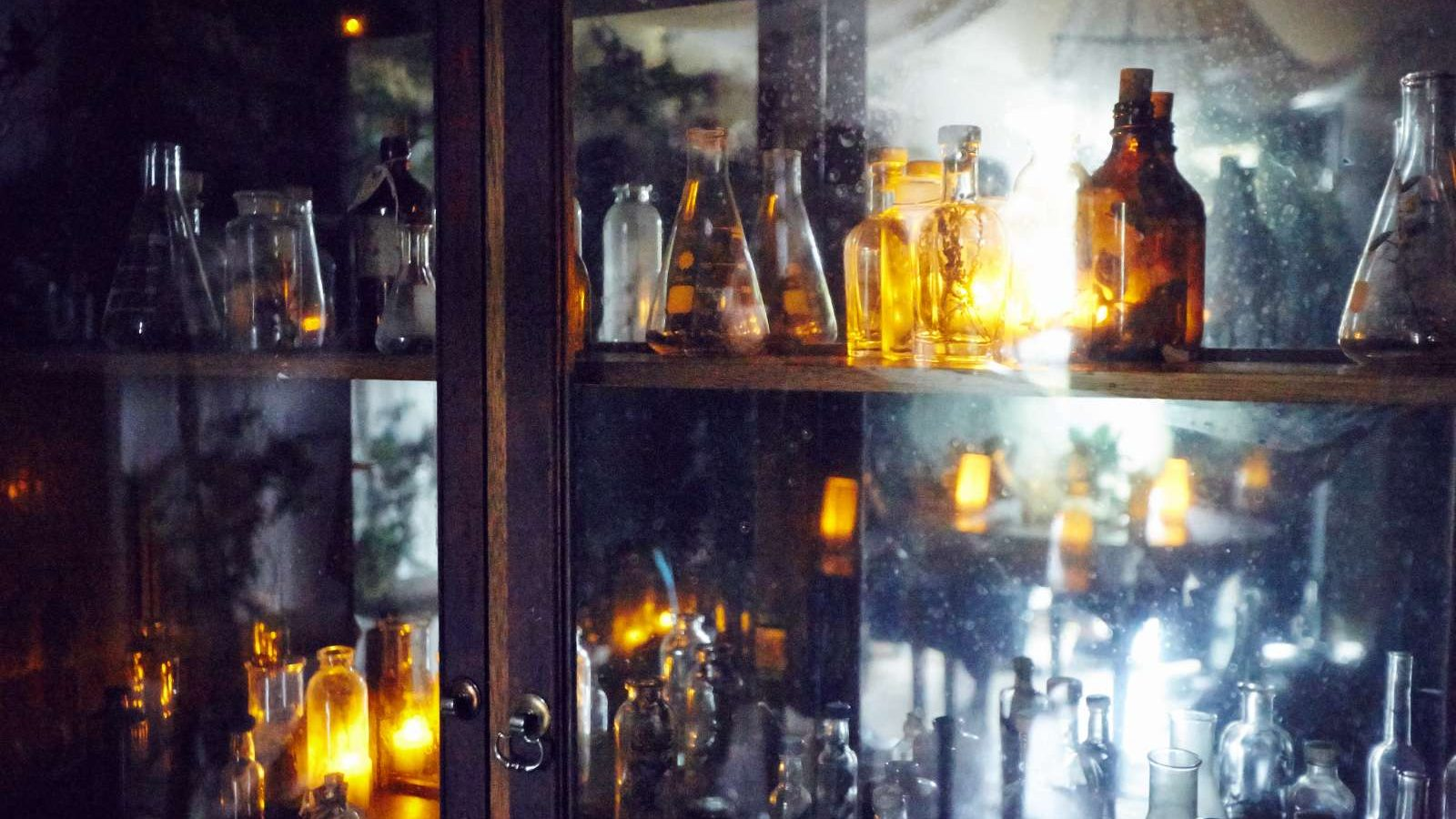 Various medicinal bottles in a glass cabinet