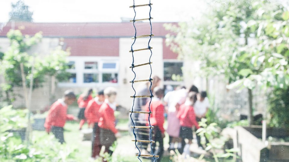 Close up of a mini ladder, children in the background