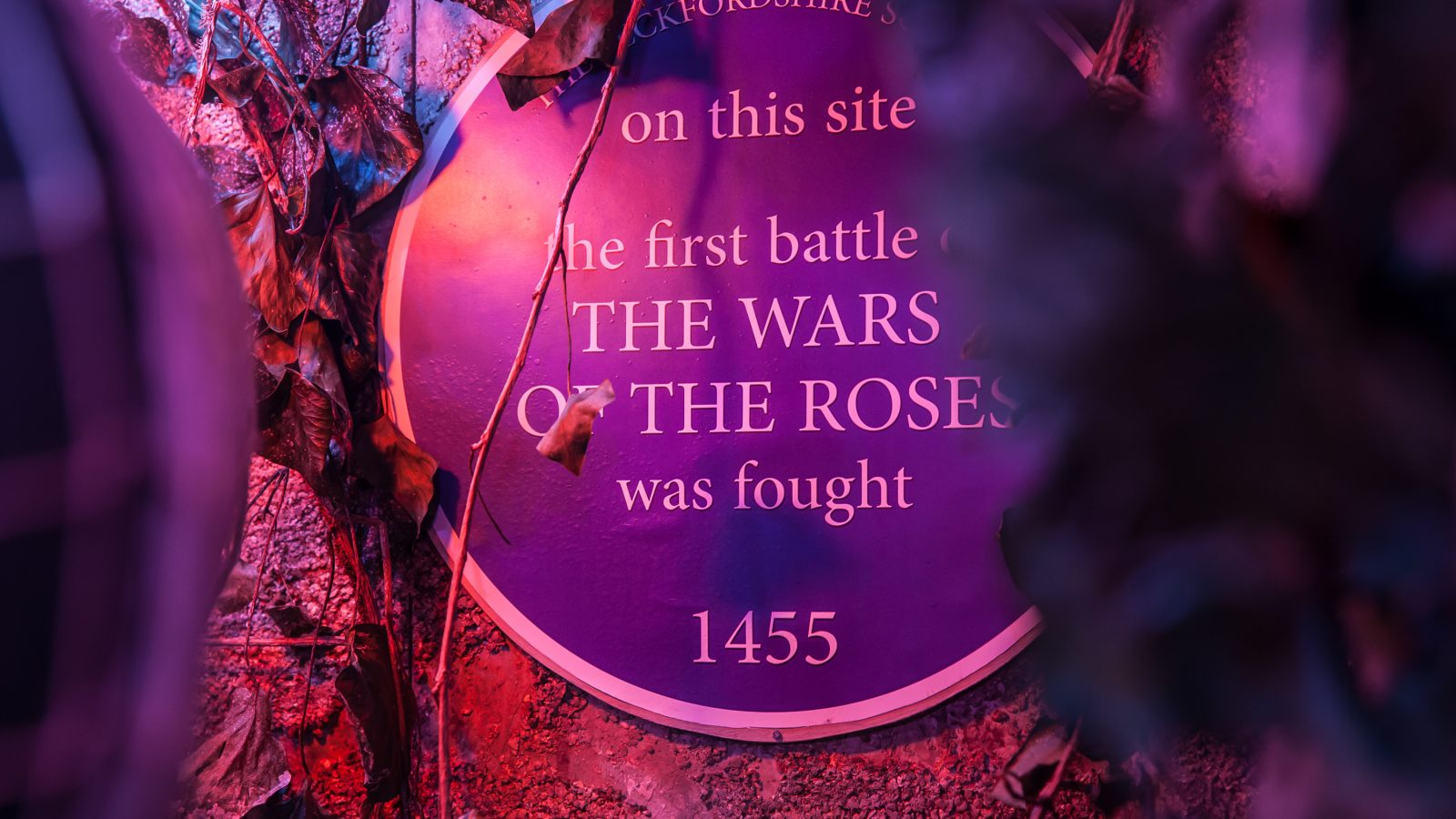 Close up of a memorial plaque on a wall