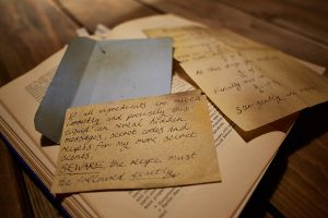 Close up of handwritten notes on top of a book